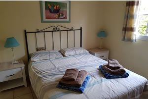 Image of bedroom with a large double bed